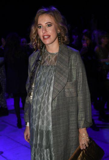 Ксения Собчак на одном из показов новой коллекции одежды в рамках Mercedes-Benz Fashion Week Russia в Центральном выставочном зале «Манеж» в Москве. 2016 год.