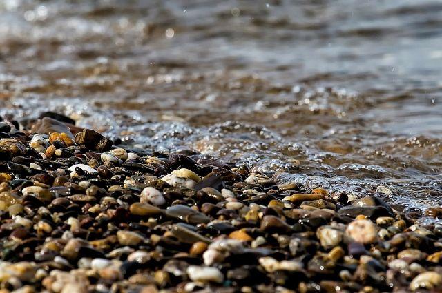 Части тела убитой женщины нашли в реке.