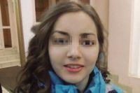 Оксана была одета в голубую куртку, как на фото.