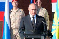 Владимир Путин на авиабазе Хмеймим в Сирии.