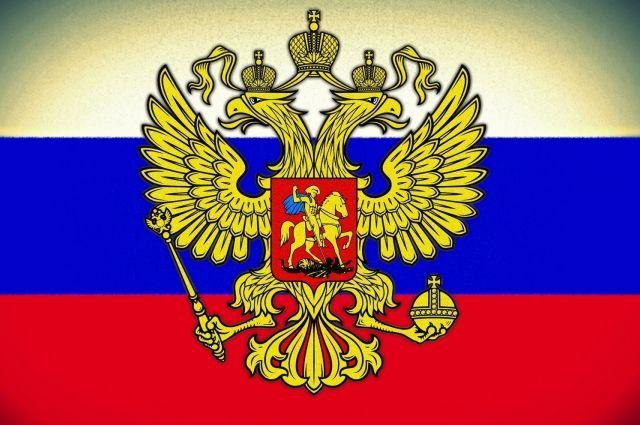 Русский герб разрешили носить наодежде