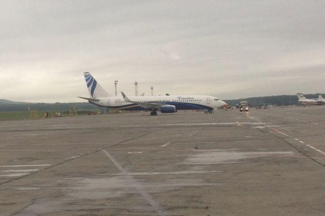 Женщину высадили из самолета.