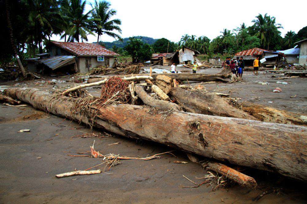 Деревня, пострадавшая от наводнения, в провинции Ланао-дель-Норте, Филиппины.