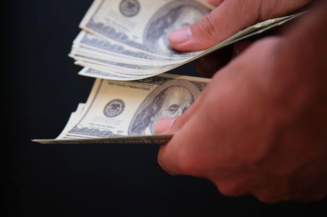 Руб. снизился кдоллару иевро следом задешевеющей нефтью