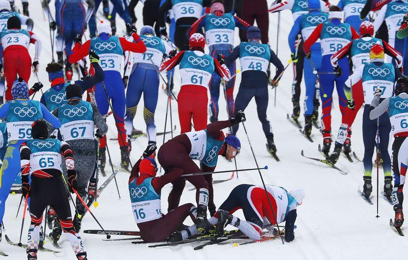 Денис Спицов (Россия), Андрей Ларьков (Россия), и Симен Крюгер (Норвегия) — скиатлон.