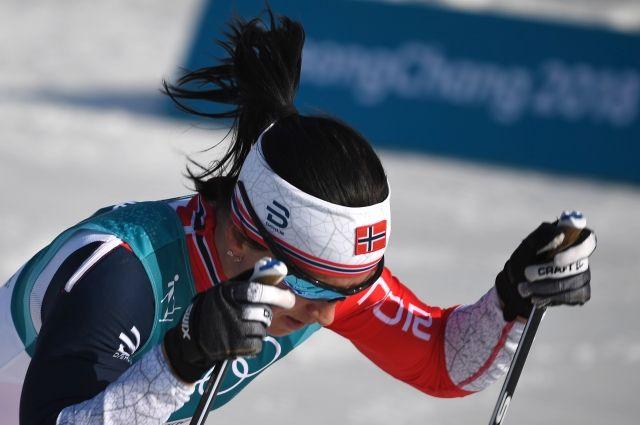 Бьорндален иДэли поздравили Бьорген с 8-ой золотой наградой Олимпийских игр