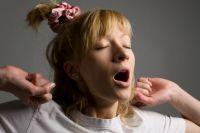 Причиной зевоты может быть не только усталость.