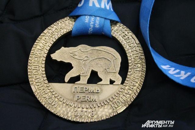 На медали Пермского международного марафона изображён медведь из древнего календаря
