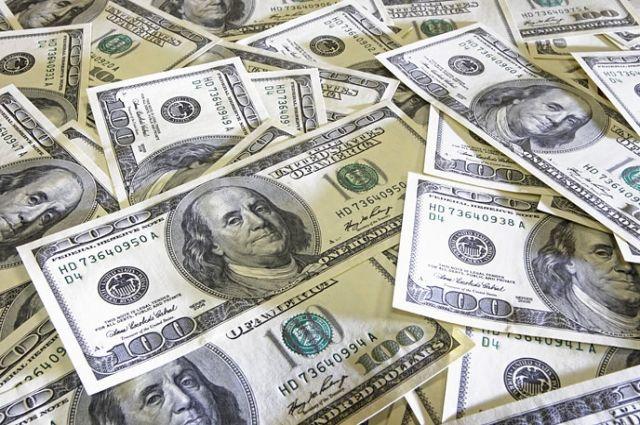 Курс доллара снизился до61,65 рубля