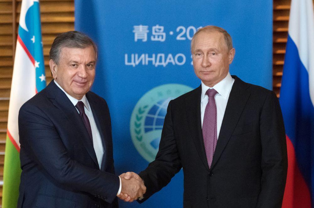 Президент РФ Владимир Путин и президент Республики Узбекистан Шавкат Мирзиёев во время встречи на полях саммита Шанхайской организации сотрудничества.