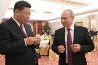 Си Цзиньпин и Владимир Путин. Фото: Алексей Дружинин