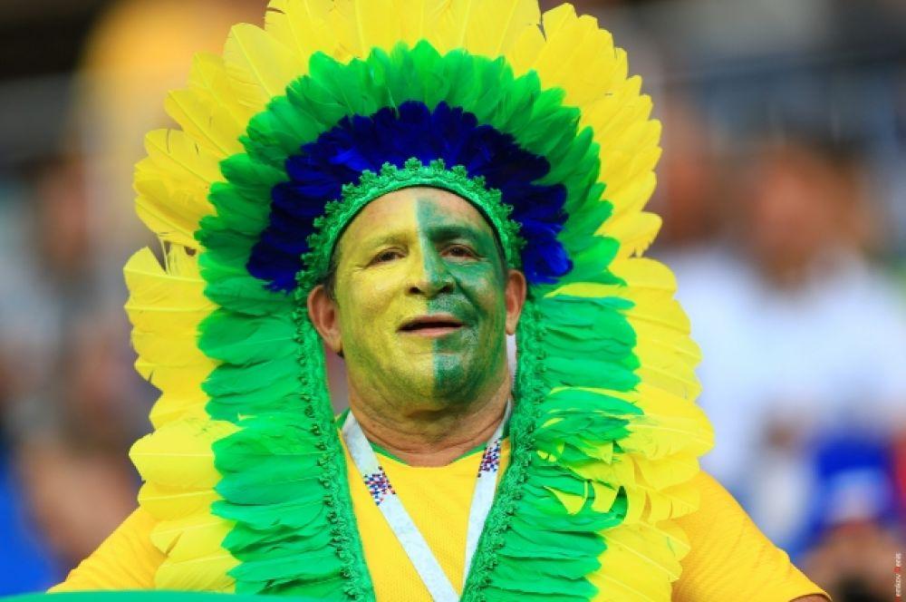 Бразильский индеец в боевой раскраске.