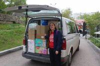 При необходимости микроавтобус превращается в фургон для доставки детям всего необходимого.