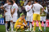 В центре: Вратарь Джордан Пикфорд (Англия) после полуфинального матча чемпионата мира по футболу между сборными Хорватии и Англии.
