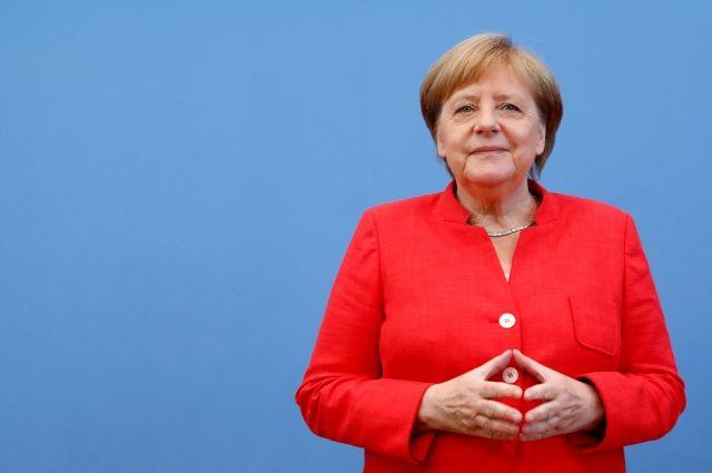Меркель прокомментировала встречу В. Путина иТрампа