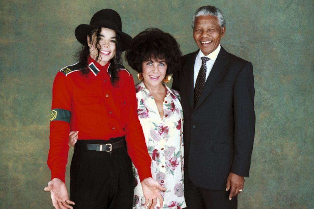 С Элизабет Тейлор и Нельсоном Манделой отеле Beverly Wilshire в Беверли-Хиллз, 1993 год.