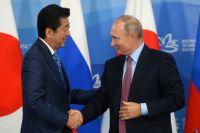 Премьер-министр Японии Синдзо Абэ и Владимир Путин.