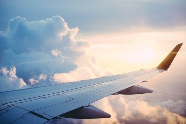 На борту самолета было 166 пассажиров.