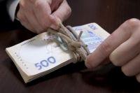 Эксперты рассказали о сценарии падения курса гривны ниже 29 за доллар