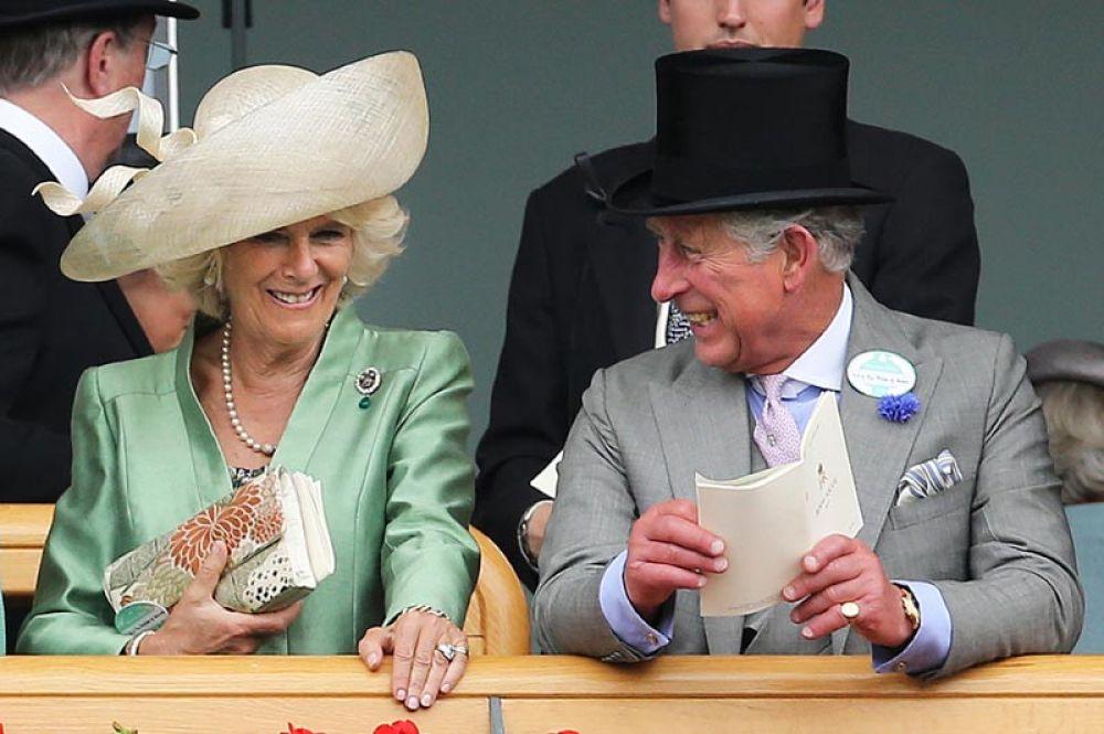 Принц Чарльз и Камилла, герцогиня Корнуольская, на скачках Royal Ascot. 2013 год.