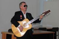Вячеслав Климов пишет песни, которые поёт под гитару.