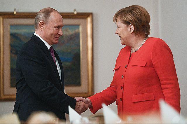 1 декабря 2018. Президент РФ Владимир Путин и канцлер ФРГ Ангела Меркель во время встречи «на полях» саммита «Группы двадцати» в Буэнос-Айресе.