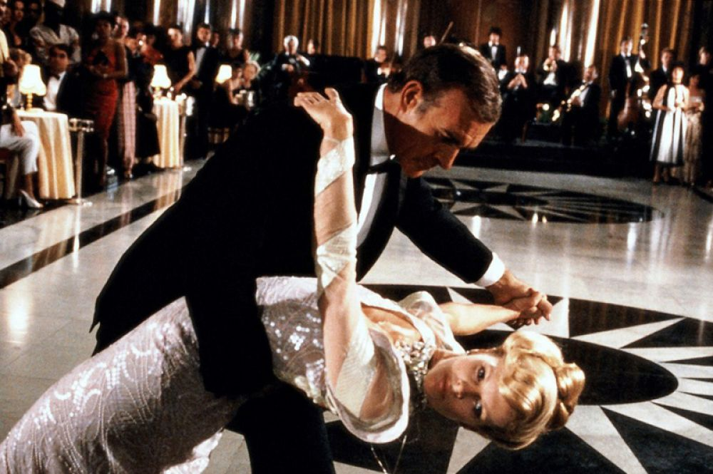 """В 1983 году Бейсингер снялась в картине «Никогда не говори """"никогда""""» из серии фильмов о Джеймсе Бонде, где сыграла девушку агента 007."""