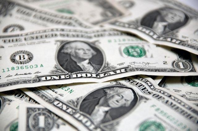 Курс доллара на Мосбирже вырос до 65,58 рубля