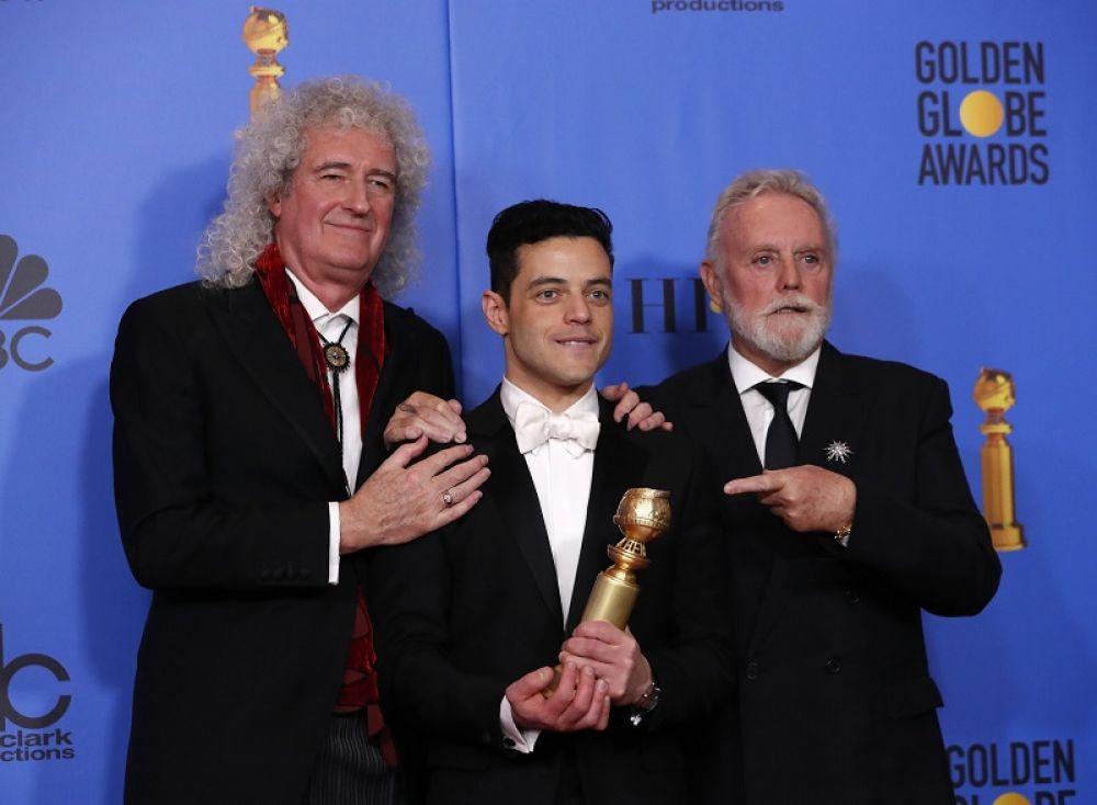 Рами Малек и музыканты группы Queen.