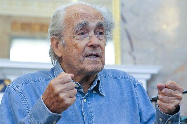 Французский композитор и музыкант Мишель Легран.