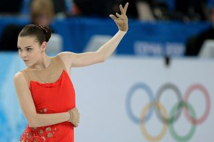 Аделина Сотникова (Россия) выступает в короткой программе женского одиночного катания на соревнованиях по фигурному катанию на XXII зимних Олимпийских играх в Сочи.