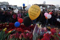 Участники акции в память о погибших при пожаре в торговом центре «Зимняя вишня» в Кемерове.