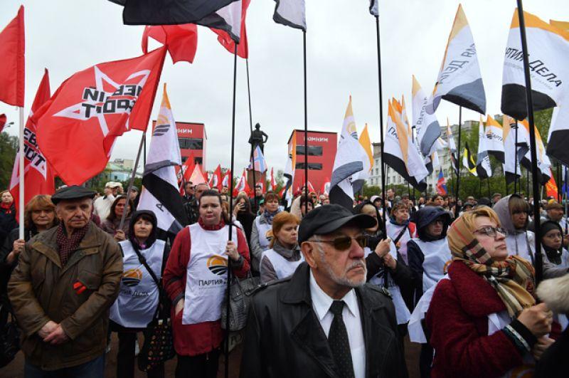 Участники митинга «Помни Одессу!» наСуворовской площади вМоскве, приуроченного кпятой годовщине событий водесском Доме профсоюзов.