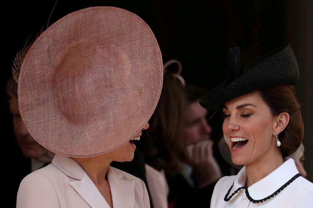 Королева Нидерландов Максима и Кэтрин, герцогиня Кембриджская, в Виндзорском замке.