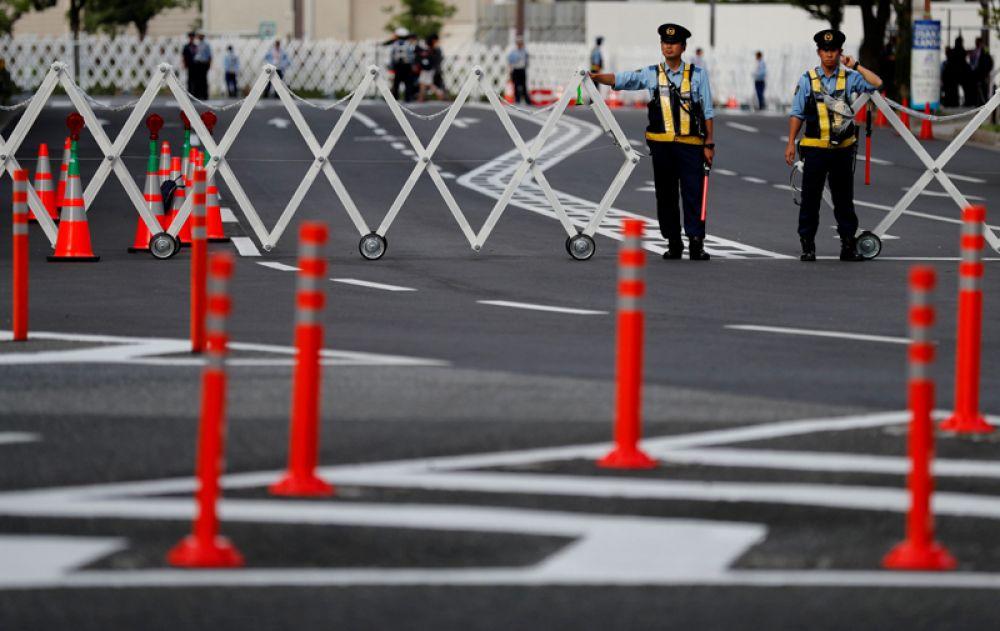 Полицейские дежурят перед местом проведения саммита G20.