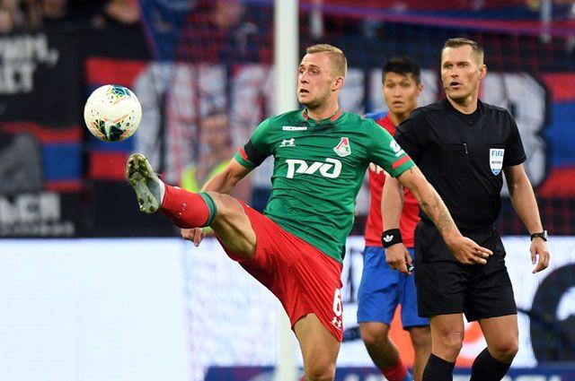 Игрок «Локомотива» Дмитрий Баринов вматче 3-го тура чемпионата России пофутболу.