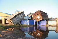 Разрушенные паводком дома в городе Тулун в Иркутской области.