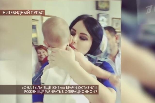 Диана Келасова с крестником.