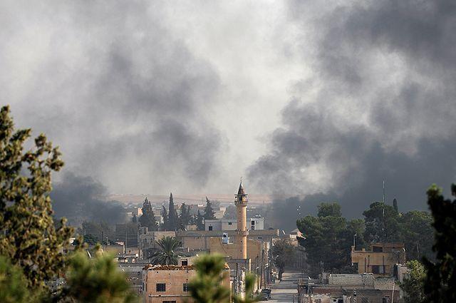 Сирийский город Эт-Телль-эль-Абьяд (граница с Турцией).