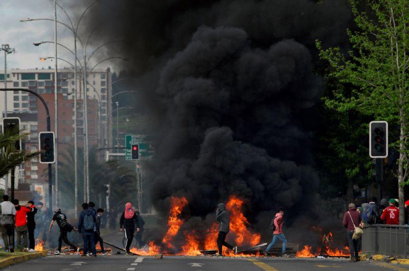 Горящие баррикады на улицах Консепсьона.