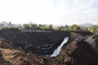 Эксперты доказали, что возгорание произошло из-за того, что много лет туда, где открытым способом добывался уголь, сбрасывали мусор.