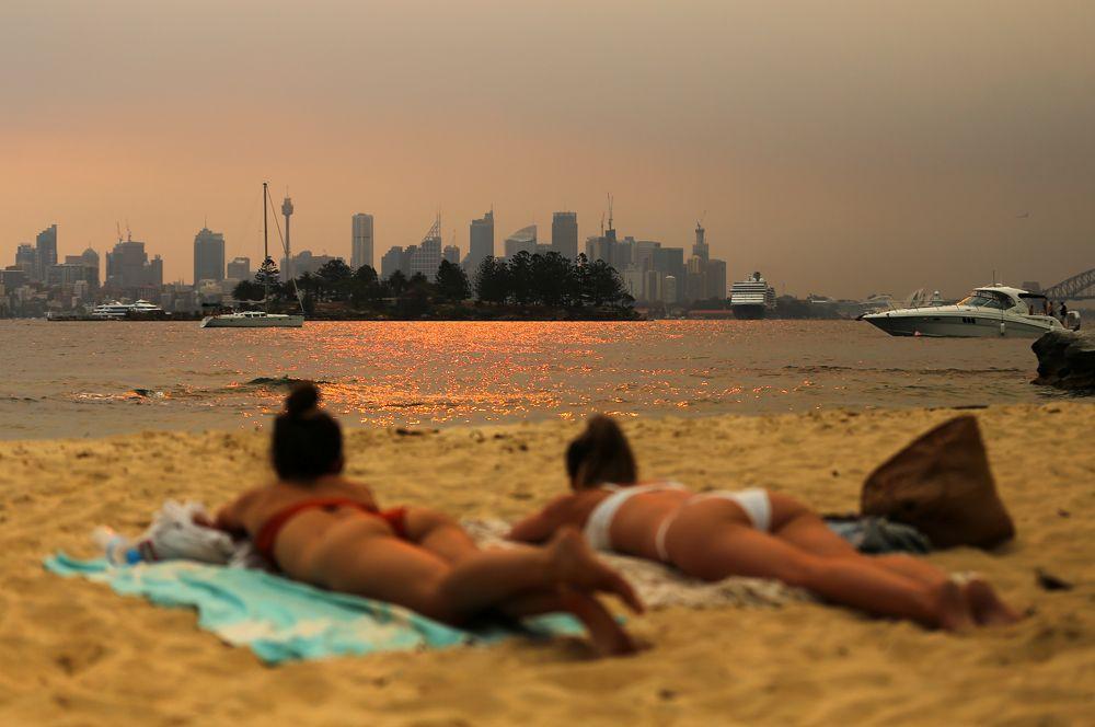 На пляже Милк-Бич в Сиднее.