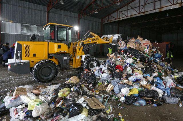 Вывоз отходов со свалки на переработку.