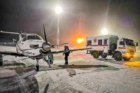 Вот на таком самолёте в метель прилетели аушеры в Норильск - и пересели в скорую-КАМАЗ.