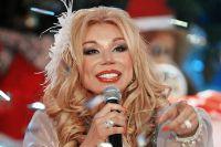 Певица Маша Распутина во время съемок развлекательной программы «Новогодняя ночь на Первом канале», 2015 год.