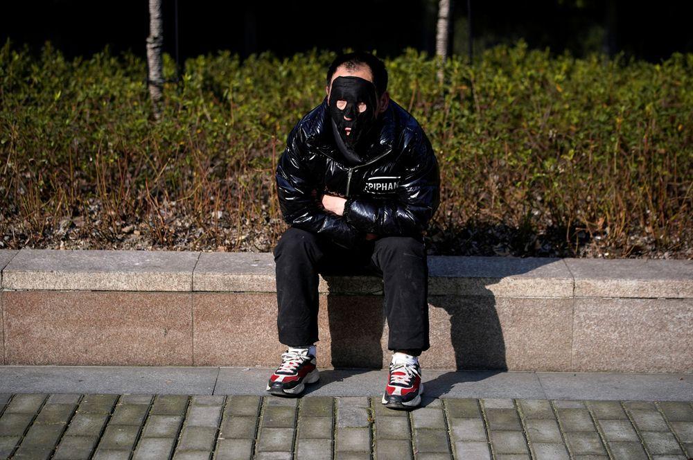 Мужчина в парке, Шанхай.