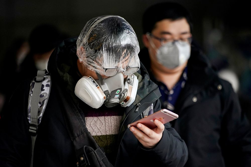 Мужчина в респираторе, Шанхай.