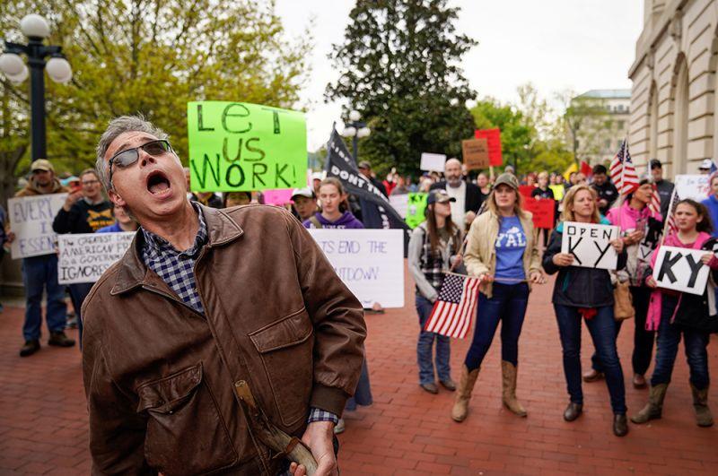 Франкфорт, Кентукки. Надпись на плакате: «Позвольте нам работать».