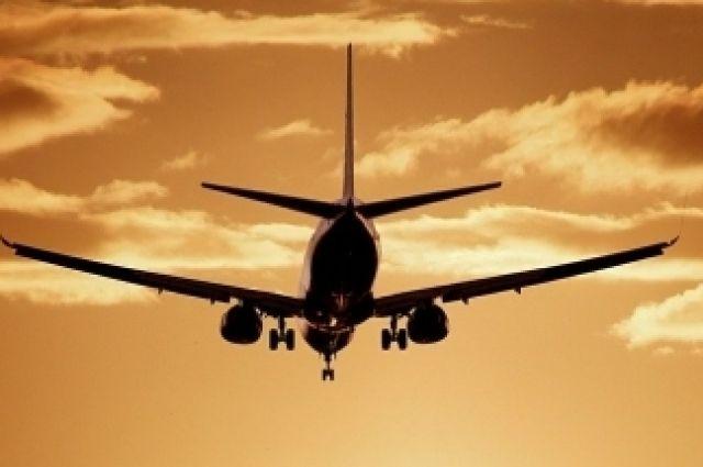 На борту самолета было 158 пассажиров.