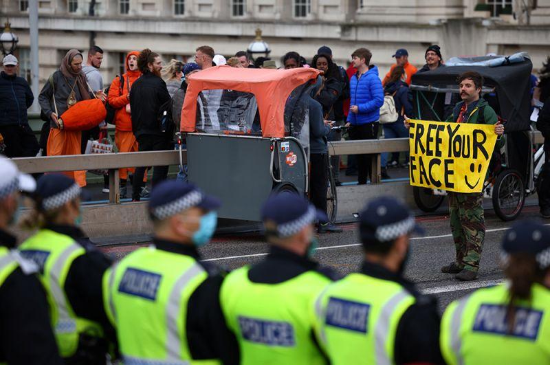 Участники марша в Лондоне, Великобритания.